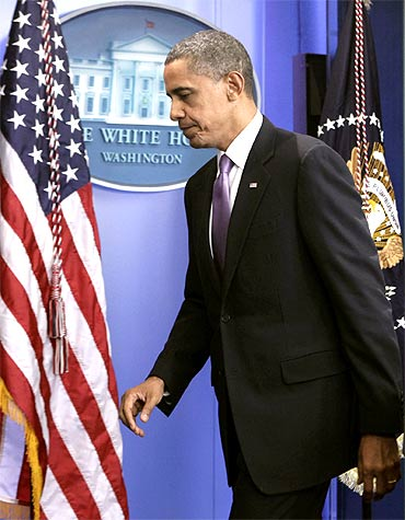 US President Barack Obama leaves after making a statement at the White House
