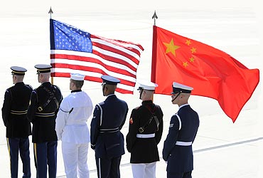 A colour guard of US and Chinese flags awaits President of China Hu Jintao's plane in Washington