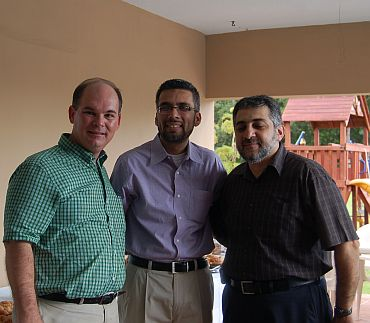 Eugene Flinn with Faisal Kaleem (centre) and Nidal (Right)