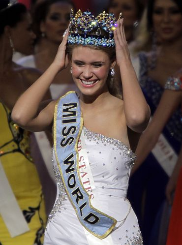 Miss USA Alexandria Mills, 18, holds her crown after wining the Miss World 2010 title in Sanya, on the Chinese island of Hainan