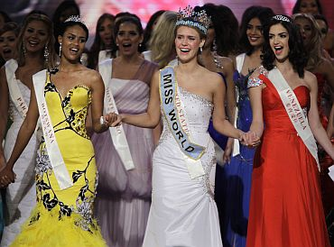 Miss USA and Miss World 2010 Alexandria Mills, first runner-up Miss Botswana Emma Wareus and runner-up Miss Venezuela Adriana Vasini celebrate at the end of the 60th Miss World pageant in Sanya