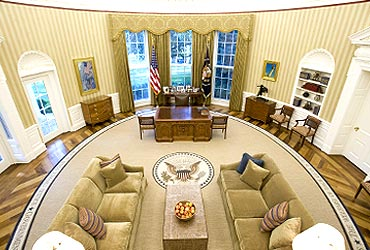 The redecorated Oval Office has new carpeting, wallpaper and sofas