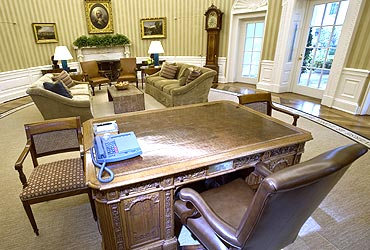 New rug, sofas and wallpaper are part of the redecorated Oval Office