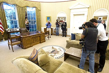 Photojournalists document the newlook Oval Office