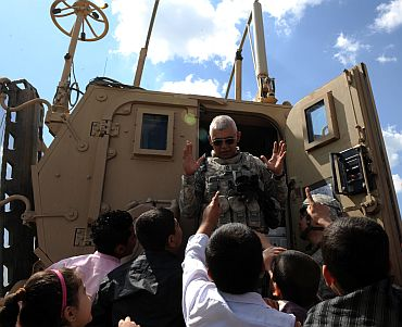 US Army Sgt 1st Class Refugio finishes handing out stuffed animals to children during a Kurdish New Year celebration in the Qarah Anir region of Kirkuk, Iraq, March 21, 2010