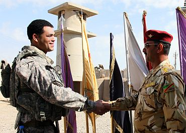 US Army Cpt Victor Morris, F Co 5-2 Infantry Commander, meets with Lt Col Abdulah Jarih-Wohayed, 4226 Iraqi Army (IA) Battalion Commander at IA head quarters in Baghdad