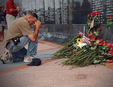 A mourner pays final respects at the Jacksonville Veterans Memorial Wall