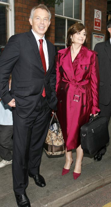 Britain's former prime minister Tony Blair with wife Cherie
