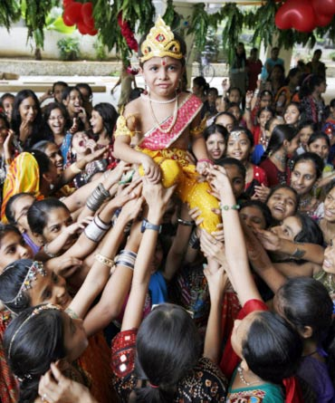 A boy dressed as Lord Krishna during Janmashtami celebrations