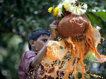 A visually impaired boy breaks a Dahi Handi