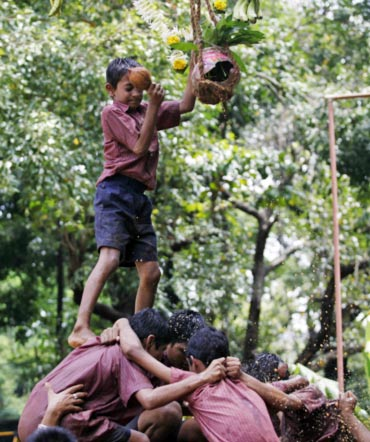 Visually impaired children form a human pyramid as they try to break a Dahi Handi