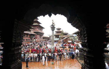 Devotees stand in a queue in front of the Krishna Temple in Patan