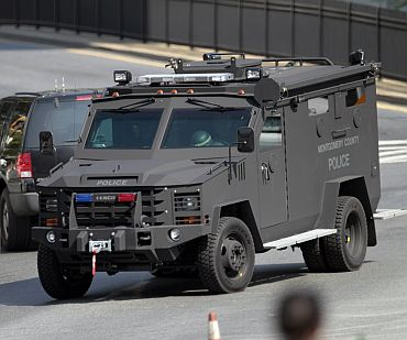 An armored police vehicle drives through the area near the Discovery Channel headquarters building