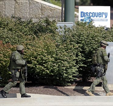 Armed police surround the area near the Discovery Channel headquarters building