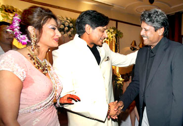 Former Team India captain Kapil Dev greets the newly wedded couple at a reception in New Delhi