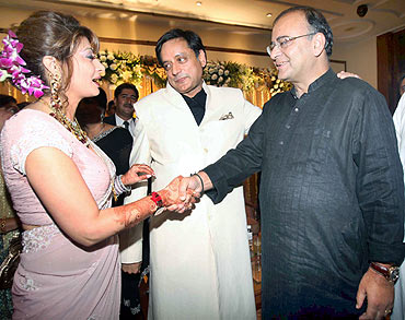 Leader of Opposition in Rajya Sabha Arun Jaitely extends greetings to Tharoor and Pushkar at a reception in New Delhi