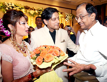 Union Home Minister P Chidambaram presents a bouquet of flowers to the newly wedded couple