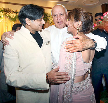 Former chief minister of Jammu and Kashmir and Union minister Farooq Abdullah congratulates the newly weds