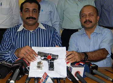 Joint Police Commissioner (Crime) Himanshu Roy (left) shows the weapon recovered from one of the hitmen