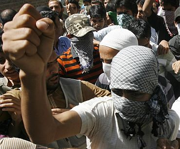 Kashmiri protesters shout pro-freedom slogans during an anti-India protest in Srinagar