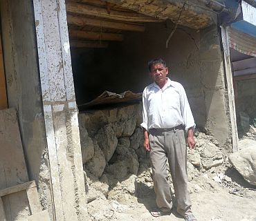 Tsering Motup outside his shop