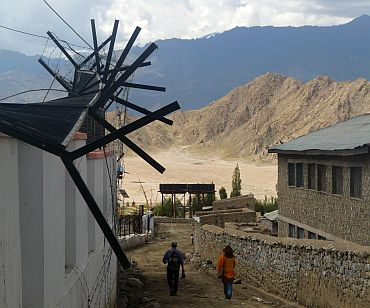 The fence outside the All India Radio station in Leh bent out of shape