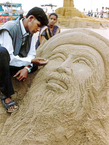 Patnaik adds the final touches to a sand sculpture of Osama bin Laden