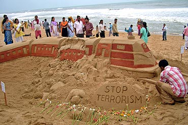 Patnaik gives finishing touches to a sand sculpture of Mumbai serial train blasts