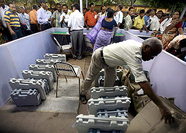 A polling officer arranges EVMs at an election control office in Kolkata