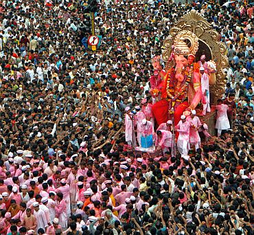 Devotees carry a Ganesh idol for immersion