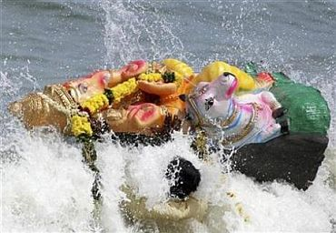 A Ganesh idol washes up on the Mumbai shoreline a day after it was immersed