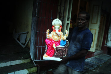 A finished Ganesha idol being taken to the warehouse