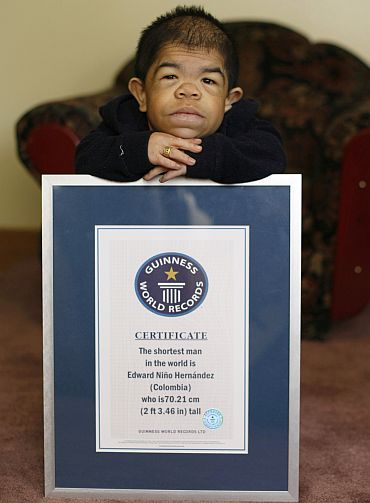 Edward Nino Hernandez poses with his Guinness World Records certificate in his home in Bogota