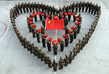 Paramilitary recruits form a heart pattern to celebrate the Chinese Lunar New Year