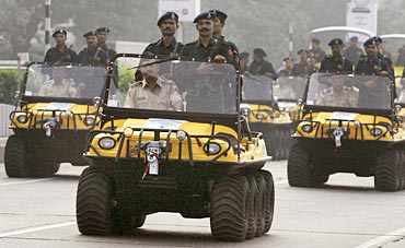 Policemen on amphibious vehicles attend a parade in Mumbai November 26, 2009