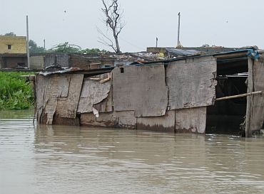 A submerged hut in Asmanpur village, located along the banks of the Yamuna