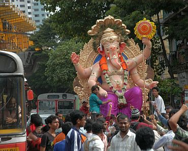 A Ganesha idol being taken in a procession