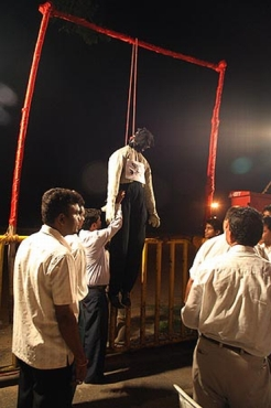 Protestors stage the mock hanging of a terrorist