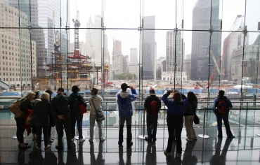 People look over the site of the former twin towers in New York City