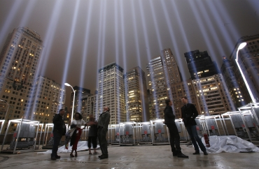 Onlookers stand inside the 'Tribute in Lights in Manhattan'