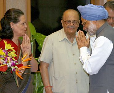 Congress chief Sonia Gandhi greets Dr Singh as senior party leader Arjun Singh looks on