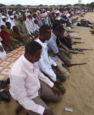 Guns and prayers mark Eid here
