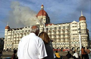 Smoke billows from the Taj Mahal hotel during the 26/11 terror attack