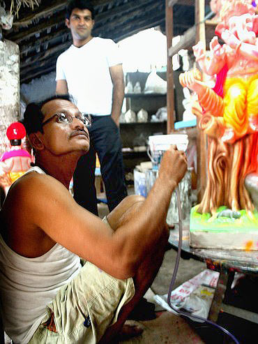 Shekhar Samel at work on an idol