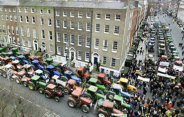 Irish farmers park their tractors in Merrion Square during a protest in Dublin