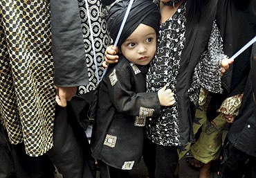 A child participates in a demonstration held in Mumbai