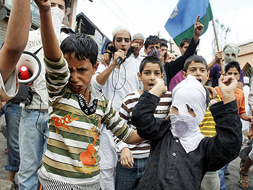Kashmiris shout slogans during a protest on the outskirts of Srinagar