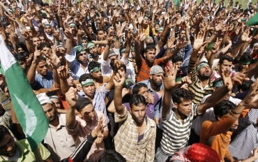 Kashmiri protesters participate in an anti-India protest in Khonmuh, south of Srinagar