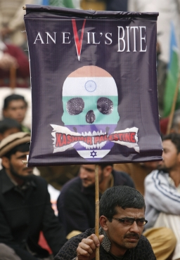 A supporter of the Jamaat-e-Islami holds a banner at a protest to show solidarity with Kashmiris during an anti-India rally in Lahore