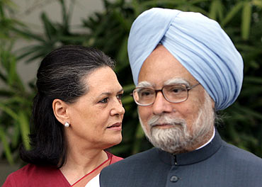 Prime Minister Dr Manmohan Singh and Congress chief Sonia Gandhi attend a news conference in New Delhi